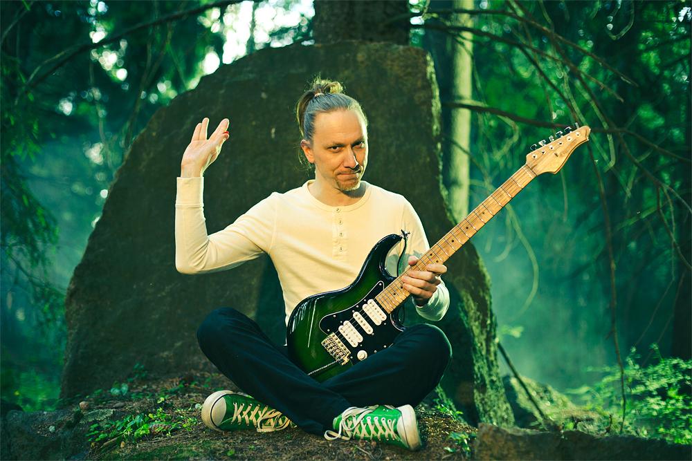 Mika Tyyskä, composer, guitarist, animator in green forest